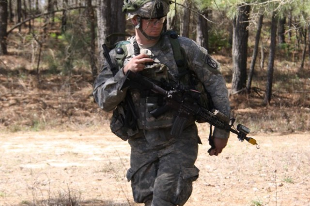 A Soldier from the 4th Brigade Combat Team, 10th Mountain Division (Light Infantry), uses the Rifleman Radio to communicate during a training exercise at Fort Polk, La. The Rifleman Radio is a key component of Capability Set 13, which extends the tactical network down to the dismounted Soldier.