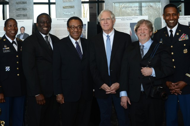 CSM Emma Krouser (left),Defense Media Activity Director Ray Shepherd ( 2nd from left) and Defense Information School Commandant Jeremy Martin (far right) congratulate Clarence Page (third from left), John Roswell Camp (center) and Jim Bryant, three DINFOS alumni who were inducted into the DINFOS Alumni Hall of Fame during a ceremony on March 14