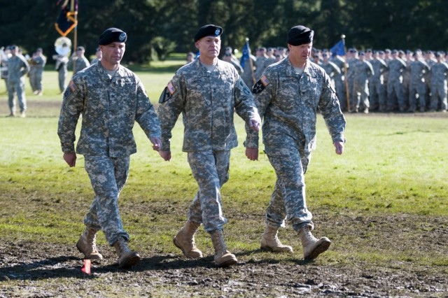 "(Left to right) Col. Hugh D. Bair incoming commander, 3rd Styker Brigade Combat Team, 2nd Infantry Division, Maj. Gen. Stephen R. Lanza, commander, 7th Infantry Division, and Col. Charles Webster, outgoing commander, 3rd SBCT, 2nd ID, complete their pass in review during a change of command ceremony held at Watkins Field, Joint Base Lewis-McChord, Wash., March 8, 2013. Bair took command of the ""Arrowhead"" Brigade from Webster after Webster commanded the brigade for 30 months, which included a yearlong deployment to Afghanistan in support of Operation Enduring Freedom from 2011 to 2012. (U.S. Army photo by Staff Sgt. Chris McCullough)"