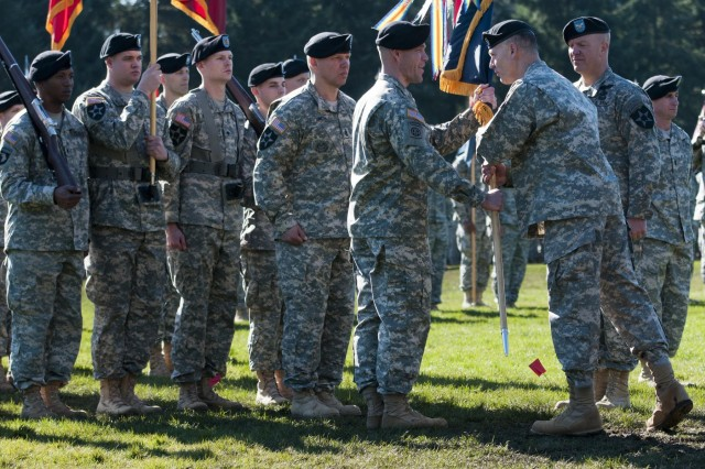 "Major Gen. Stephen R. Lanza (second from right), commander, 7th Infantry Division, hands the colors of the 3rd Stryker Brigade Combat Team to the incoming commander, Col. Hugh D. Bair. Col. Bair took command of the ""Arrowhead"" Brigade from Col. Charles R. Webster (right) in a change of command ceremony held at Watkins Field, Joint Base Lewis-McChord, Wash., March 8, 2013. (U.S. Army photo by Staff Sgt. Chris McCullough)"
