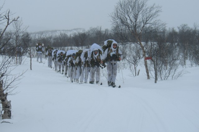 Norwegian soldiers are seen during their three-day ski march. Thirty volunteers were outfitted with physiological strain monitors and swallowed ingestible temperature pills to monitor activity and core temperature continuously during the ski march. Volunteers also consumed stable isotopes to measure energy expenditure and protein metabolism. Stefan Pasiakos, Ph.D., from USARIEM, along with Svein Martini, a principal scientist from FFI, headed out into the cold to track their volunteers during the approximately 60-mile trek.