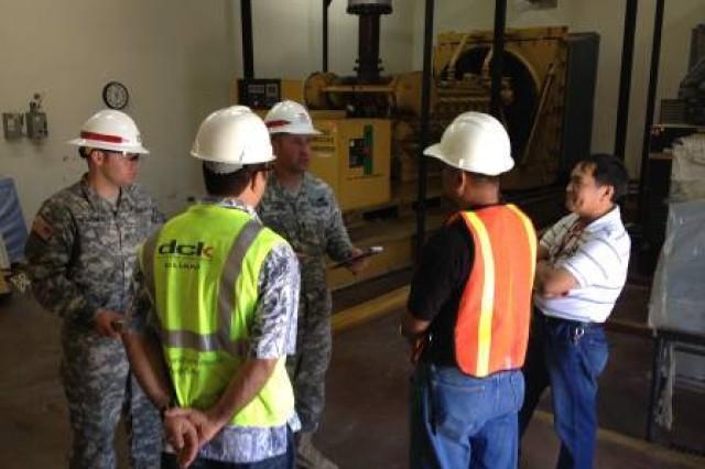 Sgt. 1st Class Brian George and Sgt. Daniel Hemphill, both Soldiers with 249th Engineer Battalion (Prime Power), are briefed on Guam Memorial Hospital's electrical infrastructure.