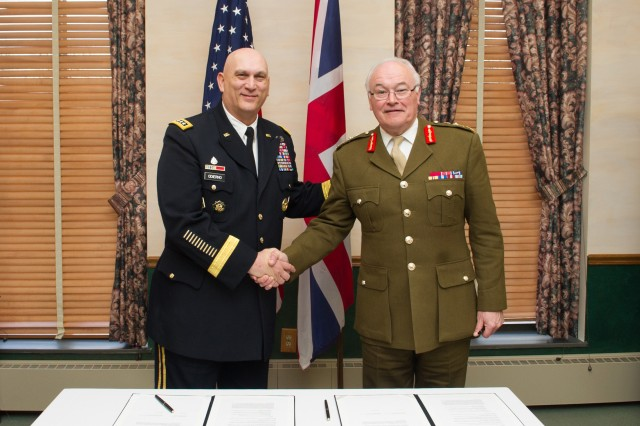 Chief of Staff of the Army Gen. Raymond Odierno and British Army Gen. Sir Peter Wall, Chief of General Staff, sign a Bilateral Strategic Vision at the National War College at Fort McNair in Washington, D.C., March 27, 2013. The Bilateral agreement will strengthen the U.S. and U.K. Army cooperation.