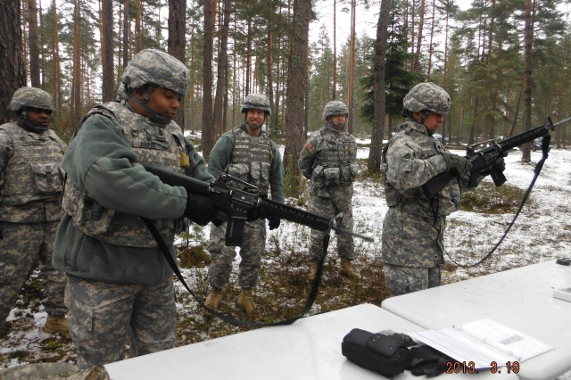 (Left to right) Sgt. 1st Class Darry Buckner, Sgt. Maj. Marlon Cooper, Maj. Mark Corn, Staff Sgt. David Humfleet and Lt. Col. Lynda Royse perform a functions check on their M16 rifles as part of the field training exercise.  (U.S. Army Photo)