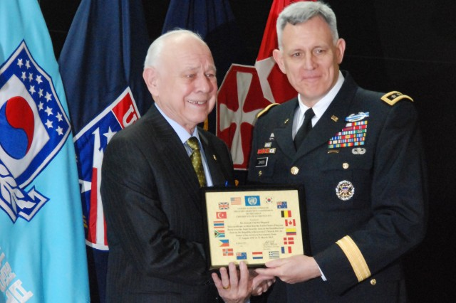 Joseph Shepard, left, receives a certificate of appreciation and other awards from Lt. Gen. John D. Johnson, commanding general of Eighth Army, during Shepard's federal service retirement ceremony, March 28, at U.S. Army Garrison Yongsan, Seoul, Korea. (Photo by Nikki Maxwell)