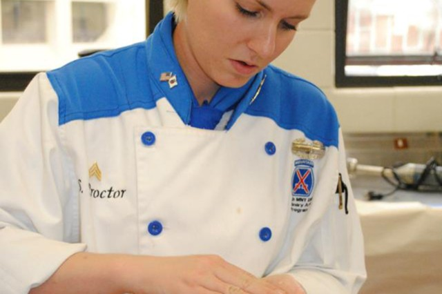 Sgt. Sarah Proctor begins to make her meal as part of the Senior Chef event at the 2013 Military Culinary Arts Competitive Training Event.
