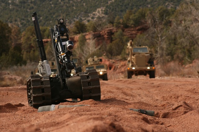 FORT CARSON, Colo. -- A Talon robot operated by engineers with 2nd Platoon, 576th Engineer Company, 4th Engineer Battalion, inspects ordnance as engineers keep a safe distance. From March 12-17, engineers performed mounted and dismounted route-clearance patrols near Camp Red Devil, gathering intelligence and preparing for an upcoming rotation at the Joint Readiness Training Center at Fort Polk, La., and future deployment to Afghanistan.