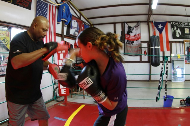 Allyanna Bates, 12, throws a right hook against sparring partner, David Vaughn in the Madman Boxing ring March 21, 2013, in Elgin Okla. Bates quickly reacted to the commands Vaughn called out, landing punch after punch. Bates is a Fort Sill family member.