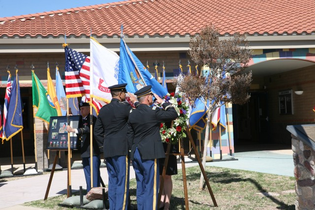From left, Command Sgt. Maj. Todd Holiday, U.S. Army Intelligence Center of Excellence and Fort Huachuca, and Col. Roger Sangvic, commander, USAICoE, salute the flag after they placed the wreath in honor of Capt. Christopher Seifert on Friday. Seifert was the first Military Intelligence Corps member and commissioned officer to die in Operation Iraqi Freedom.