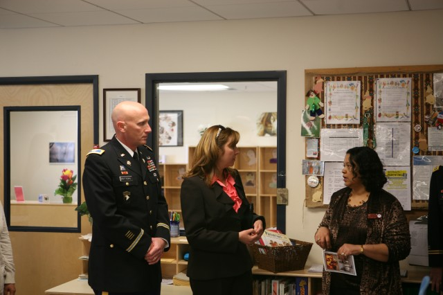 From left, Col. Jim Botters, director, Office of Military Intelligence, U. S. Army Intelligence Center of Excellence and Fort Huachuca, and his wife Gina tour the Seifert School Age Center with Jennifer Lotten, center director, following the Capt. Seifert Remembrance Ceremony on Friday. The School Age Center was dedicated to Seifert nine years ago.