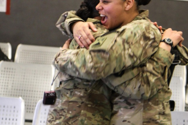 "PARWAN PROVINCE, Afghanistan - Army Spc. Janice Pagan, an automated logistical specialist assigned to Forward Support Company, 1st Battalion, 187th Infantry Regiment, 3rd Brigade Combat Team ""Rakkasans,"" 101st Airborne Division (Air Assault), hugs her twin sister Army Spc. Janet Pagan, a unit supply specialist assigned to 72D Expeditionary Signal Battalion as they reunite for the first time in more than two years at Bagram Airfield, Afghanistan, March 17, 2013. Despite being in separate units both twins were deployed within a month of one another to eastern Afghanistan. (U.S. Army Photo by Spc. Brian Smith-Dutton TF 3/101 Public Affairs)"