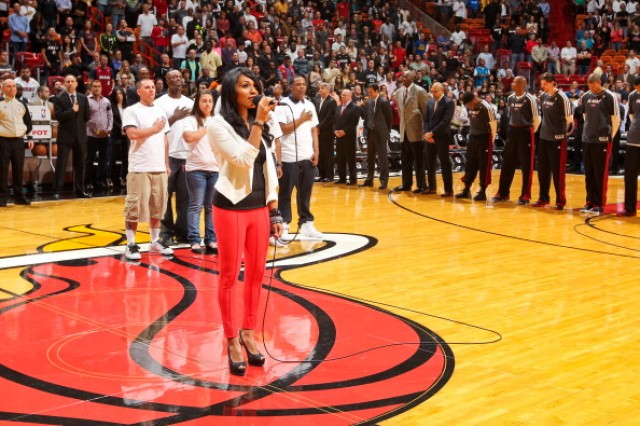 Transitioning Soldiers, recently hired by The Commercial Driver's License (CDL) School, take center court during the singing of the national anthem before the March 8 NBA game pitting the Miami Heat against the Philadelphia 76ers.