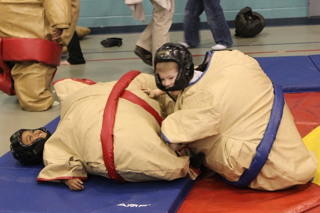 Kivon Farrow (blue) pins Orlando Silva-Warren (red) during a sumo wrestling match at the School Age Center carnival March 22, 2013. It was one of the many activities held at Fort Sill, Okla., during spring break.