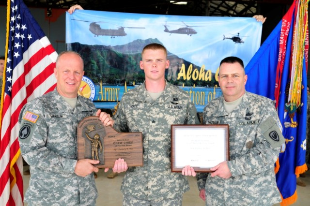 Sergeant Zachary Rice (Center) was selected as the 2012 Army Aviation Association of America's Henry Q. Dunn 2012 Crew Chief of the Year.  Sgt. Rice was presented with the award by Command Sgt. Maj. James Thomson (Right), Command Sergeant Major of the Army Aviation Center of Excellence, on Wheeler Army Airfield, Hawaii, March 25.  Maj. Gen. Kevin Mangum (Left), Commander of the Army Aviation Center of Excellence, also attended the award ceremony to congratulate Rice on his achievement.