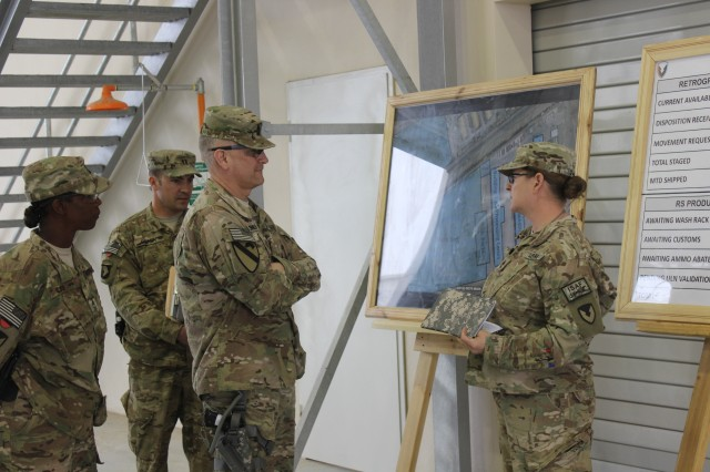 Sgt. 1st Class Lesa Dash provides an overview of the current retrograde process in the new Kandahar RPAT to Sgt. Maj. of the Army Raymond  Chandler. (Photo by Sharonda Pearson, 401st AFSB Public Affairs)