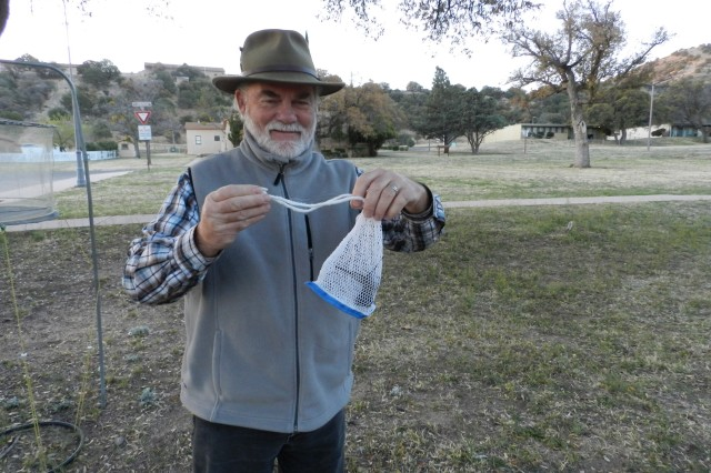 Stephen Siemsen, volunteer, holds a captured female magnificent hummingbird, one the larger species. After the netting comes down around the feeder, volunteers will reach under the net and gently place the bird in nylon net bags so they can be banded.