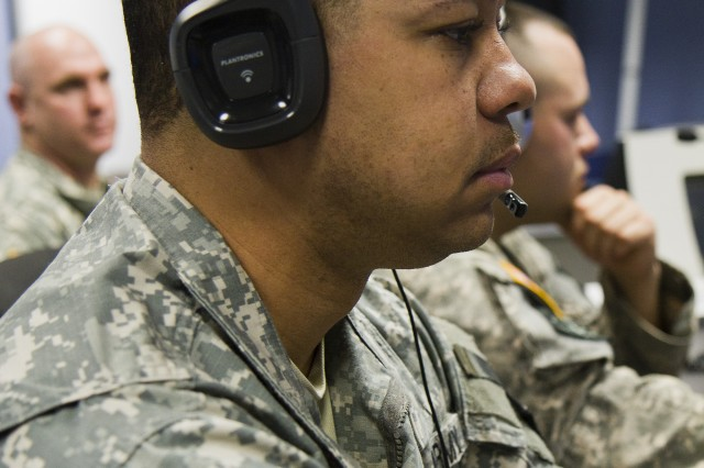FORT MEADE, Md. -- Army Reserve Staff Sgt. Darren Love, from Columbia, Md., communicates with 200th Military Police Command Soldiers at Camp Walker, Korea, during Exercise Key Resolve 2013. Love, a military police officer, worked in the command headquarters operations center at Fort Meade for the exercise. (Army Reserve photo by Sgt. 1st Class Mark Bell)