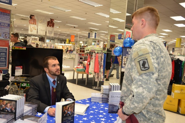 """173rd Airborne Brigade Combat Team Medal of Honor recipient Salvatore Giunta recently published a book, """"Living with Honor: A Memoir"""" and signed copies at the post exchange March 20. Giunta also visited numerous offices around the installation and joined with 173rd ABCT Soldiers at lunch at the dining facility. Giunta is now living in Colorado with his wife and daughter."""