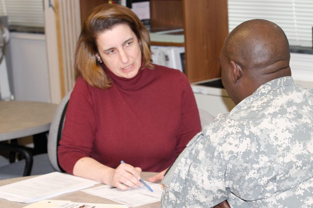 Cathy Hughes, M.A., Army Career and Alumni Program Counselor, talks with Spc. Nana Boateng, Fort Belvoir Community Hospital, about career opportunities after he leaves the Army, at the Barden Education Center, March 26.