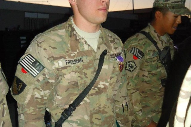 Capt. David Freeman receives a Purple Heart, November 2011 for wounds sustained while deployed to a war zone. Freeman's platoon was hit by an improvised explosion device while performing a routine inspection in southern Afghanistan in 2010. (Courtesy photo)