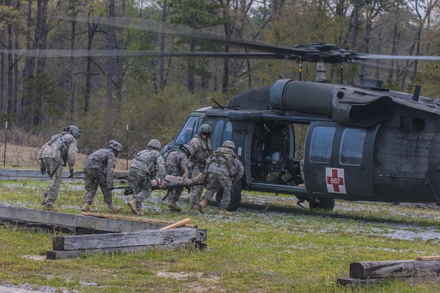 Florida National Guard Soldiers with 3rd Battalion, 116th Field Artillery, perform a Casualty Evacuation exercise, March 24, 2013, at Camp Shelby, Miss. The 3rd Bn., 116th FA are training with 177th Armored Brigade, First Army Division East for their final validations before deployment.