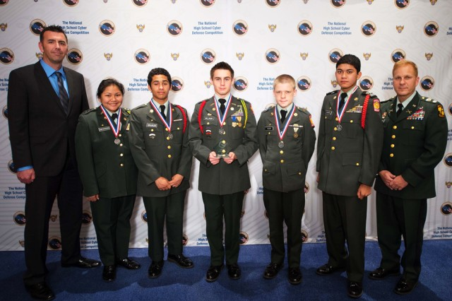 Leilehua's JROTC CyberPatriot Team is Army JROTC CyberPatriot V Service Champion 2013. From left to right are team mentor, retired Air Force Senior Master Sgt. Mike Herr; cadet/team captain Sharon Thepsenavong; cadets Michael Grajales, David Williams, Seth Allen and Kawika Lavarias; and Leilehua senior Army instructor/team coach, retired Lt. Col. Nick Spiridigliozzi.