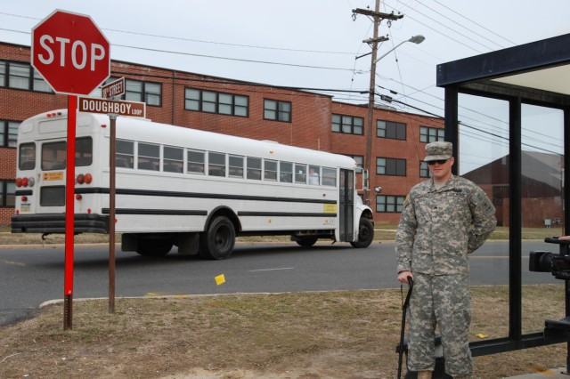U.S. Army Sgt. Nathan Martucci, a Warrior Transition Unit soldier at Joint Force Base McGuire-Dix-Lakehurst, N.J., stands at a bus stop March 11, 2013. Martucci, originally from Mount Arlington, N.J., works to improve multiple facets of his life with the help of WTU's medical staff after sustaining a traumatic brain injury during deployments to Iraq. March is Brain Injury Awareness Month. Martucci shares his experiences coping with brain injury in an effort to help raise awareness across all branches of the military. (U.S. Army photo by Sgt. Manda Walters, 129th Mobile Public Affairs Detachment)