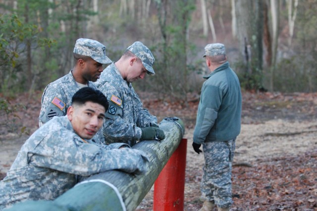 U.S. Army Sgt. 1st Class Alex Almeida with the 1st Battalion, 307th Infantry Regiment, finished the obstacle event first at Tac3 Alpha near Joint Base McGuire-Dix-Lakehurst, N.J., March 13, 2013.  Almeida is one of four competitors in the three-day noncommissioned officer of the year competition. (U.S. Army photo by Sgt. Manda Walters/Released)