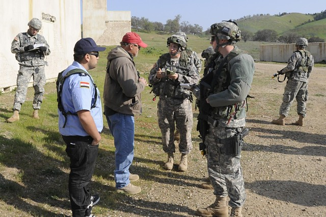 Members of a SWEAT MSO team gather information from a village mayor (red hat) during a training exercise at Fort Hunter Liggett, Calif., during Warrior Exercise 91 13-01, March 22, 2013. A SWEAT MSO mission, which stands for sewer, water, electricity, academics, trash, medical, security and other, is an assessment of a community's basic needs. Once the team gathers the info, a list of possible projects is presented to village leaders. The missions help build relations between U.S. forces and the local population in U.S. military areas of operation.Warrior Exercise 91 13-01 is designed to prepare soldiers for the rigors of deployment associated with ongoing overseas contingency operations. Thousands of soldiers from around the country are participating in this training mission provided by the 91st Training Division.