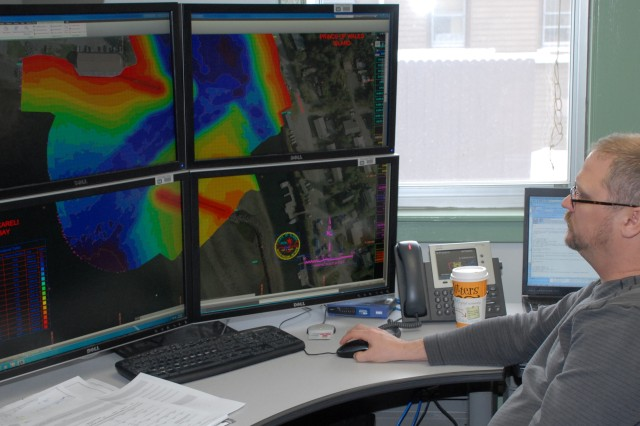 """Gene Hubbell, engineering technician in the Geomatics Section, examines a project condition survey of Craig Harbor in AutoCAD Civil 3D. The Alaska District won best project in the """"Innovative Use of Civil 3D"""" category Jan. 11 in the 2012 U.S. Army Corps of Engineers BIM Awards."""
