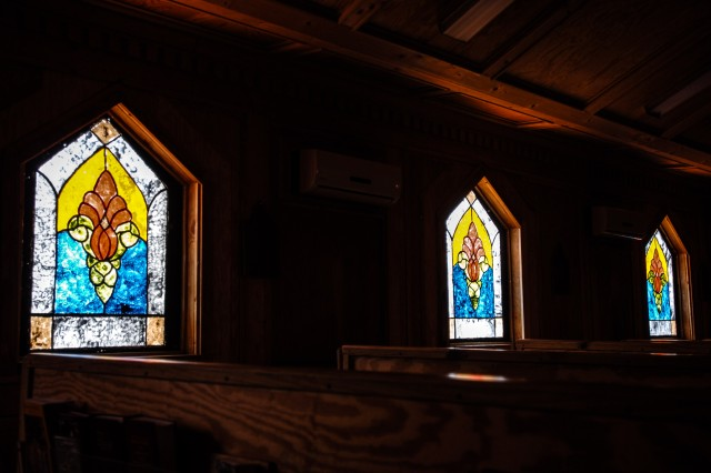 """KHOWST PROVINCE, Afghanistan """" Stained glass windows that were hand-painted by a team of chaplain's assistants are now on display at the chapel on Forward Operating Base Salerno, Afghanistan. A team of chaplain's assistants teamed up together to finish the restoration of their chapel after it was badly damaged by an attack on the FOB in the summer of 2012.The team spent more than six months on the design, construction and installation of the windows. (U.S. Army photo by Sgt. 1st Class Abram Pinnington, TF 3/101 Public Affairs)"""