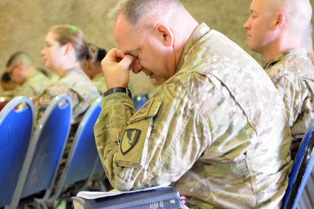 Capt. William Cale, chaplain for the 20th Engineer Battalion, prays during the Easter sunrise service at Kandahar Airfield, March 30, 2013. (U.S. Army photo by Sgt. Ashley Bell)