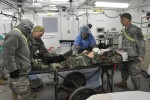 212th Combat Support Hospital Soldiers prepare a simulated casualty for surgery