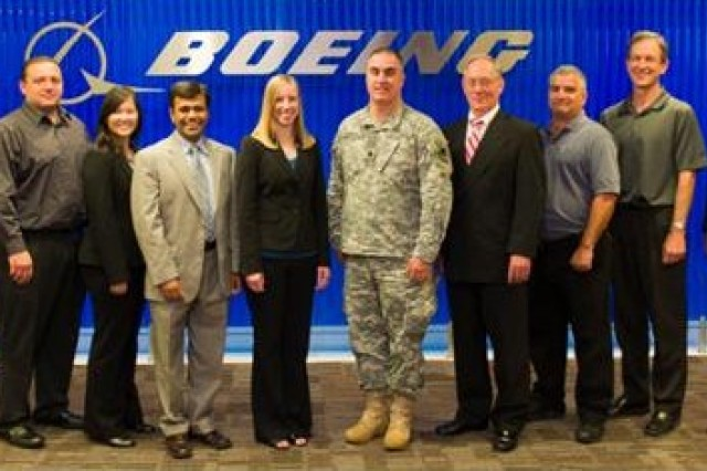 ARL-ARO representatives (center) Dr. Stephanie McElhinny and Lt. Col. Timothy Warner attended a 2012 demonstration of the DTEK system at Boeing's Huntington Beach, Calif. manufacturing site along with members of the ChromoLogic and Boeing teams.