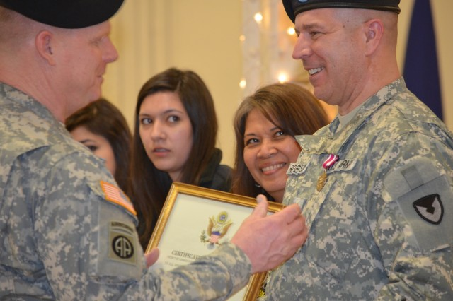 Brig. Gen. Duane Gamble, Army Sustainment Command deputy commanding general, chats with retiree Maj. Christopher Robertson as family members look on during the ASC quarterly Award, Retirement and Retreat Ceremony held in Rock Island Arsenal's Heritage Hall March 28.