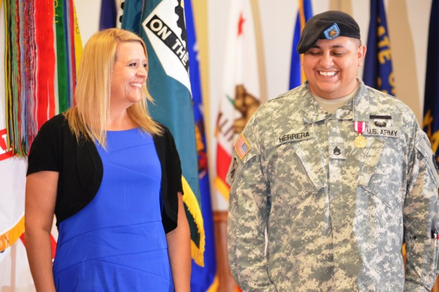 Retiree Staff Sgt. Jesus Herrera enjoys a light moment with his wife, Tammy, following the Army Sustainment Command quarterly Award, Retirement and Retreat Ceremony held in Rock Island Arsenal's Heritage Hall March 28.