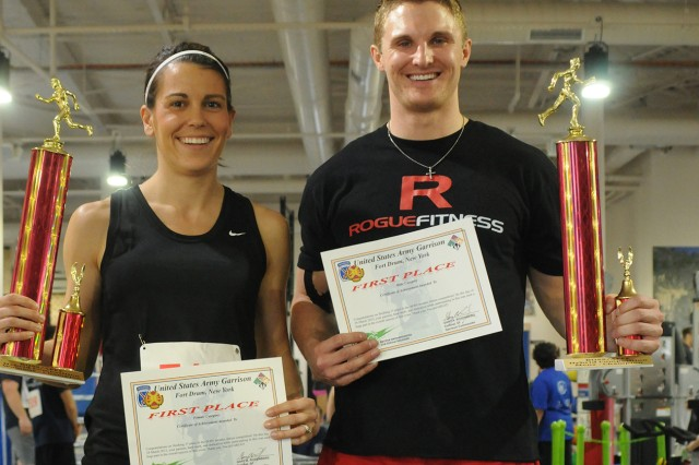 Kara Smith and Justin Wiley smile Thursday after winning the female and male titles during the first functional fitness challenge at the Atkins Functional Fitness Facility.