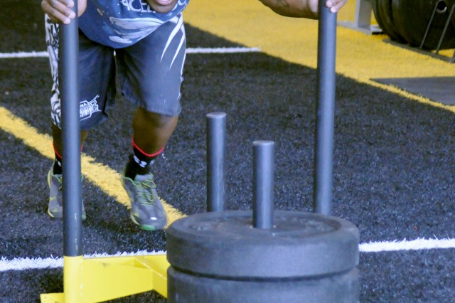 Spc. Anthony Bell completes the sled push event. Men had to push a 90-pound sled, and women had to push a 45-pound sled.