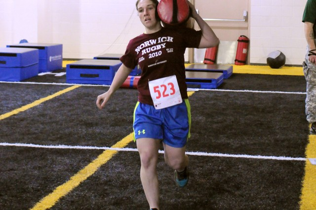 Second Lt. Melanie Dwyer, who finished third in the female category, carries a 20-pound sandbag over her shoulder during the last event of the competition.