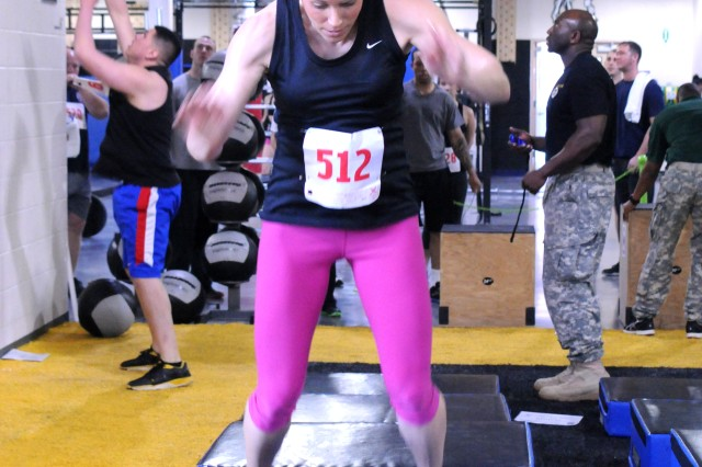 Kara Smith jumps more than 36 inches onto a box during a functional fitness challenge last week. Smith was one of 27 competitors who participated in the event.