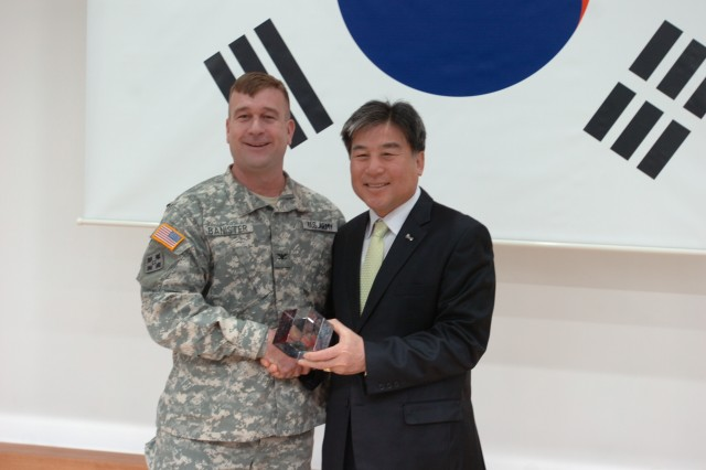 Dongducheon, South Korea, Mayor Oh Sea-chang presented Col. Tracy P. Banister, commander, 210th Fires Brigade, 2nd Infantry Division, an appreciation award for supporting the annual Wang Bang International Mountain Bike Race, April 1, 2013, at Dongducheon City Hall.