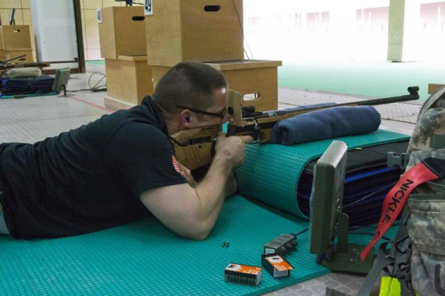 The U.S. marksmanship team brought home the bronze in the rifle challenge at the 2013 Qatar Commander-General Shooting Competition, held March 14-18, 2013, at the Lusail International Shooting Complex in Doha, Qatar. Pictured here, Capt. Patrick Nickle, 79th Military Police Company, fires from the prone position during the rifle competition.