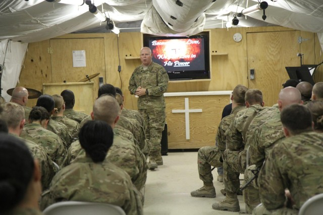 U.S. Army Maj. David Trogdon, center, a chaplain with the 4th Brigade Combat Team, 3rd Infantry Division, gives an Easter message to congregants attending a nondenominational Protestant service at Forward Operating Base Shank's St. Michael's Chapel in Logar province, Afghanistan, March 31, 2013.  (U.S. Army photo by Staff Sgt. Elvis Umanzor/Released)