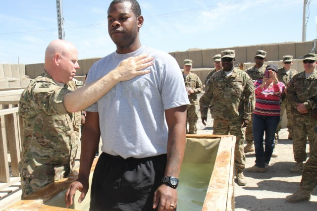 U.S. Army Maj. David Trogdon, left, a chaplain with the 4th Brigade Combat Team, 3rd Infantry Division, baptizes Sgt. Rashon Johnson during an Easter service at Forward Operating Base Shank in Logar province, Afghanistan, March 31, 2013. Trogdon was assigned to the brigade's Headquarters and Headquarters Company.  (U.S. Army photo by Staff Sgt. Elvis Umanzor/Released)