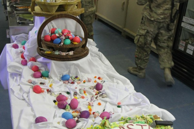 U.S. Soldiers assigned to various units including the 4th Brigade Combat Team, 3rd Infantry Division share an Easter dinner at Forward Operating Base Shank in Logar province, Afghanistan, March 31, 2013.  (U.S. Army photo by Sgt. Robert Yarbrough/Released)