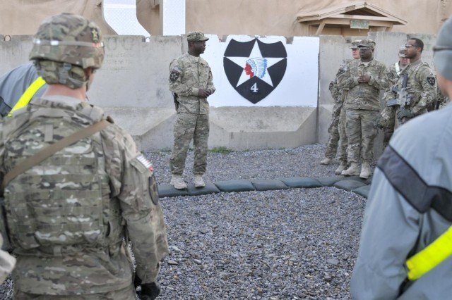U.S. Army Command Sgt. Maj. Steven Lewis, center, the senior enlisted advisor to the commander of the 2nd Battalion, 23rd Infantry Regiment, addresses graders and competitors at the start of the Top Tomahawk competition at Forward Operating Base Spin Boldak in Kandahar province, Afghanistan, March 29, 2013. The competition tested the Soldiers' physical endurance, marksmanship skills, and technical and tactical proficiency.  (U.S. Army photo by Staff Sgt. Shane Hamann/Released)