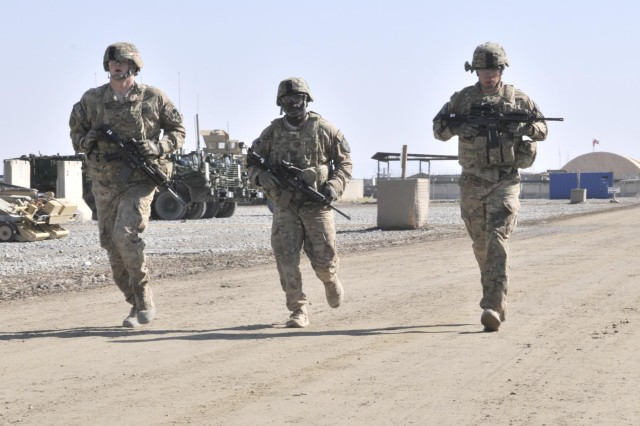 U.S. Soldiers with Alpha Battery, 2nd Battalion, 12th Field Artillery Regiment run to their next event during the Top Tomahawk competition at Forward Operating Base Spin Boldak in Kandahar province, Afghanistan, March 29, 2013. The competition tested the Soldiers' physical endurance, marksmanship skills, and technical and tactical proficiency.  (U.S. Army photo by Staff Sgt. Shane Hamann/Released)