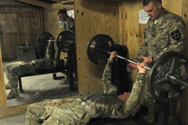 A U.S. Soldier with Charlie Company, 2nd Battalion, 23rd Infantry Regiment completes chest press exercises during the physical fitness round of the Top Tomahawk competition at Forward Operating Base Spin Boldak in Kandahar province, Afghanistan, March 29, 2013. The competition tested the Soldiers' physical endurance, marksmanship skills, and technical and tactical proficiency.  (U.S. Army photo by Staff Sgt. Shane Hamann/Released)
