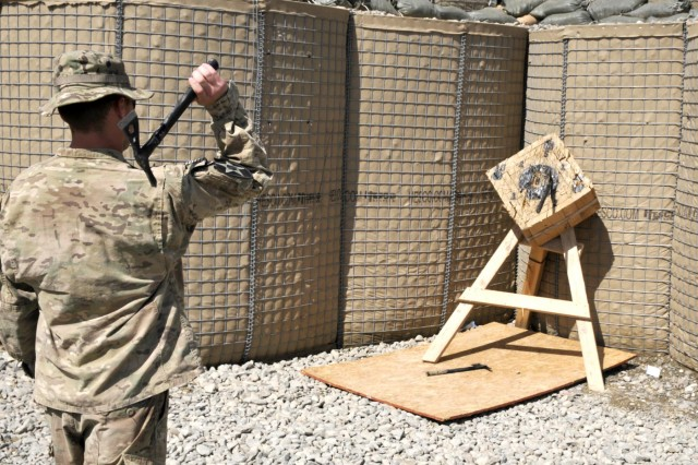 U.S. Army Spc. Kirk Calabrese with Bravo Company, 2nd Battalion, 23rd Infantry Regiment throws a tomahawk during the final event of the Top Tomahawk competition at Forward Operating Base Spin Boldak in Kandahar province, Afghanistan, March 31, 2013. The competition tested the Soldiers' physical endurance, marksmanship skills, and technical and tactical proficiency. (U.S. Army photo by Staff Sgt. Shane Hamann/Released)