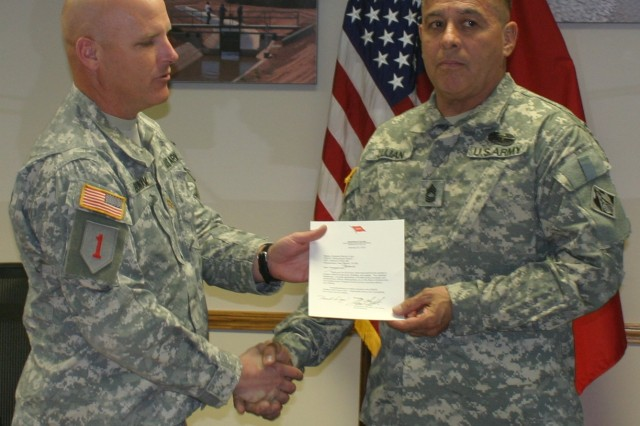 Master Sgt. Bernie Lujan received the 2012 USACE Meritorious Antiterrorism Honor Roll Award March 26, 2013, at the Albuquerque District's Headquarters in Albuquerque, N.M.